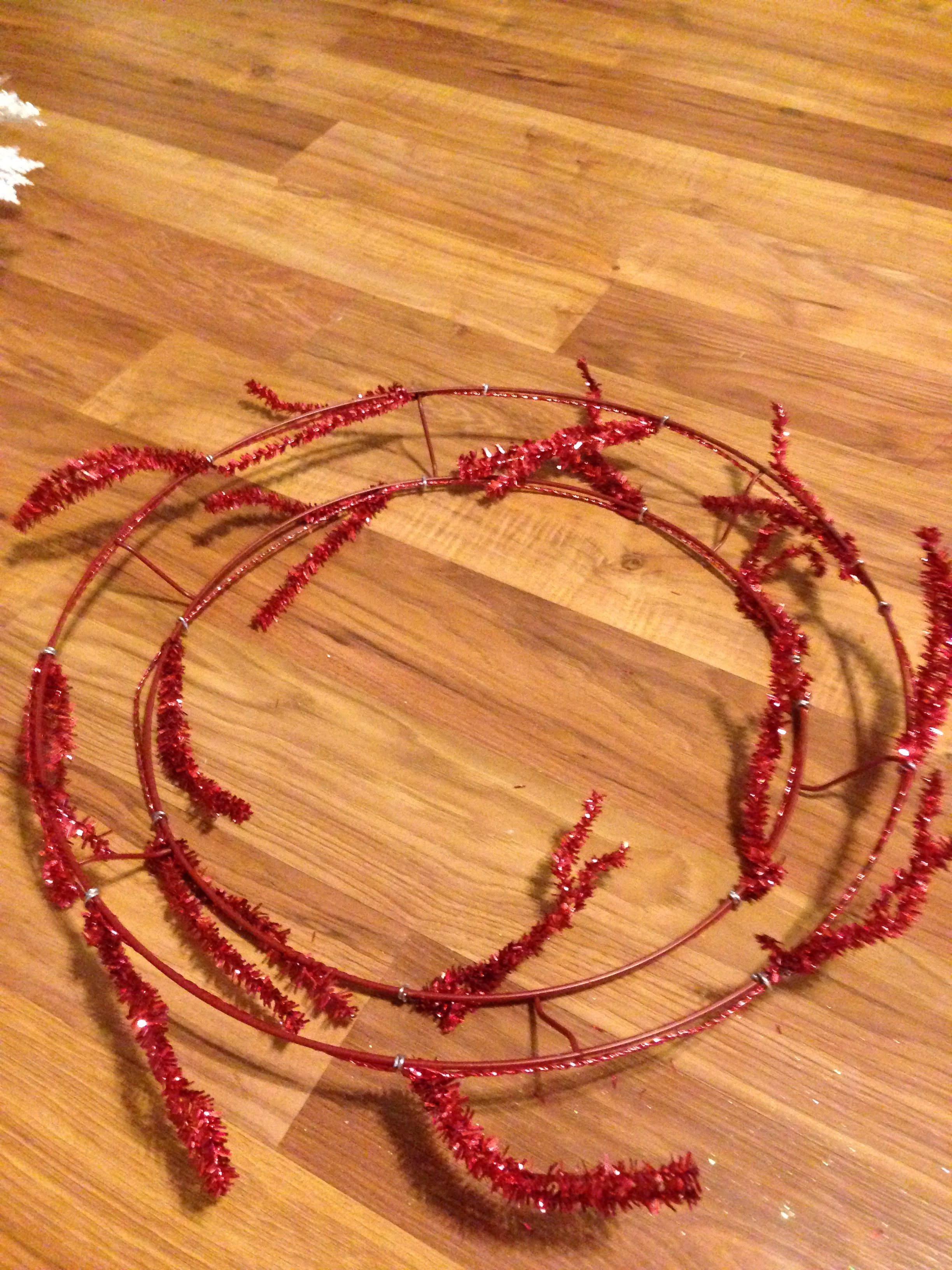 to start i selected a 16 inch red tinsel work wreath frame and a red and white striped deco mesh i found all of my supplies at my local hobby lobby - Wire Wreath Frame Hobby Lobby